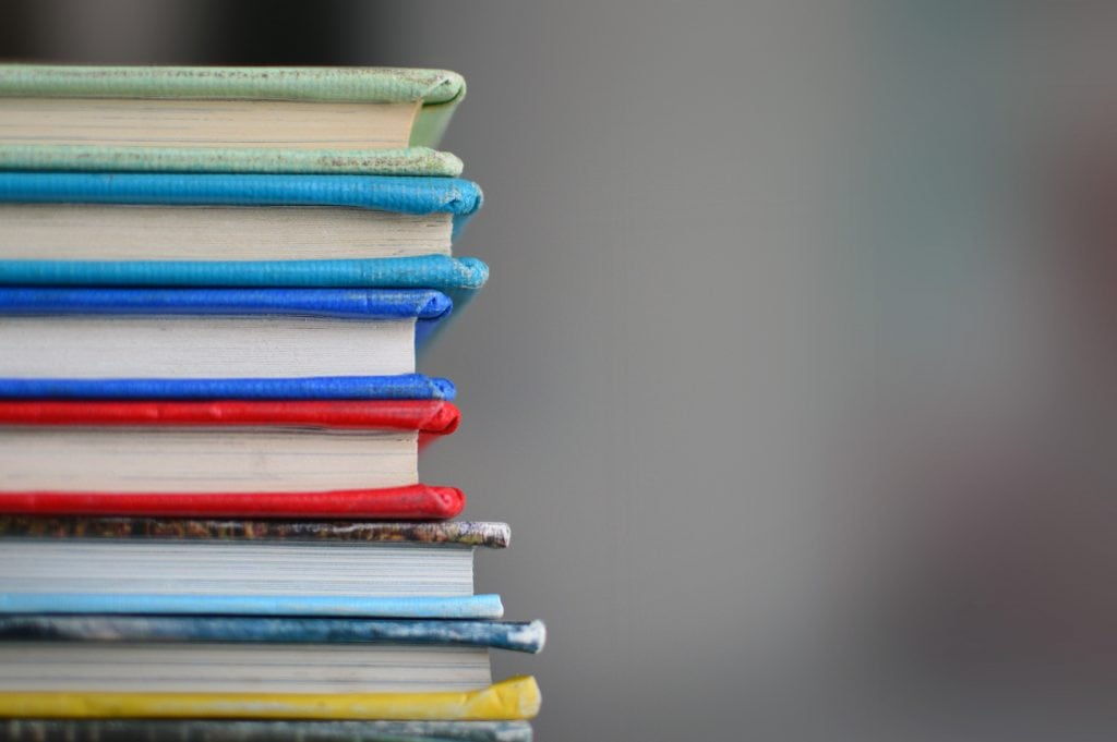 stack of colourful hardback books