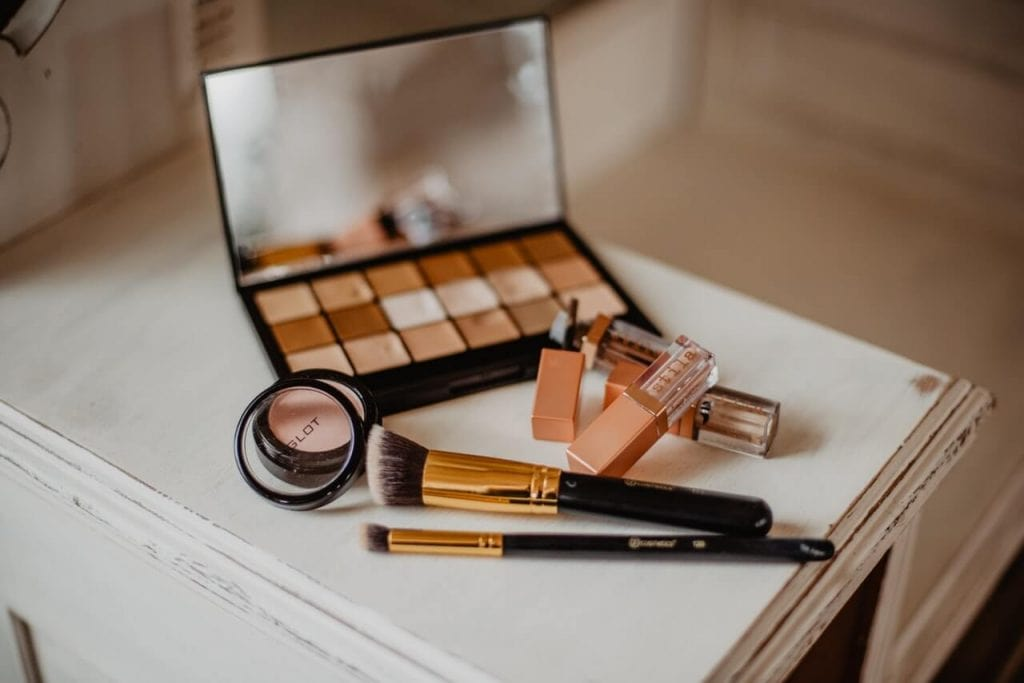 make up set on a white wood table